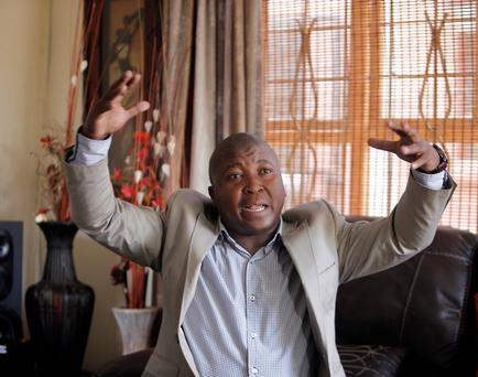 Thamsanqa Jantjie gesticulates at his home during an interview