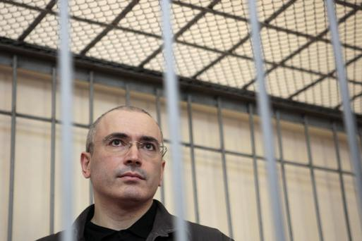 Jailed former Russian oil tycoon Mikhail Khodorkovsky stands in the defendant's cage during a court hearing in Chita in this August 21, 2008 file photo. President Vladimir Putin is to pardon him