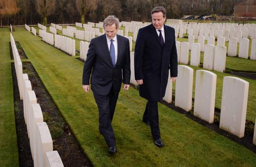 Britain's Prime Minister David Cameron and Ireland's Taoiseach Enda Kenny visit Wytschaete Memorial Cemetery where members of the Irish 16th Division and the Ulster 36th Division who died in World War I are buried, in Heuvelland, Belgium