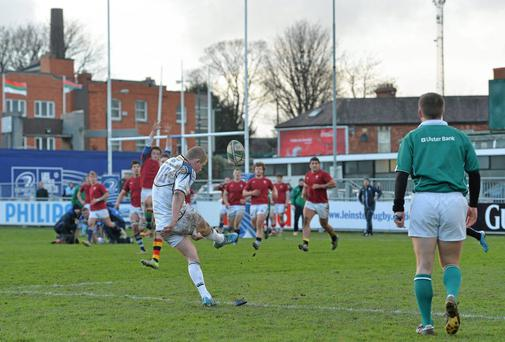 Conor McKeon, Leinster Development Squad, kicks a successful conversion to win the game for his side