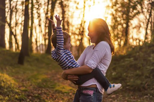 Mother and child enjoying the park in autumn day