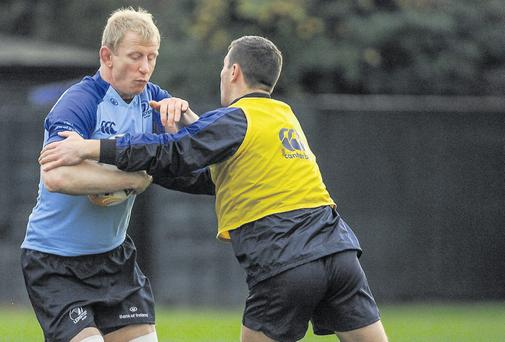 Leo Cullen, here being tackled by John Cooney during training, is back in the Leinster team. Piaras O Midheach Sportsfile