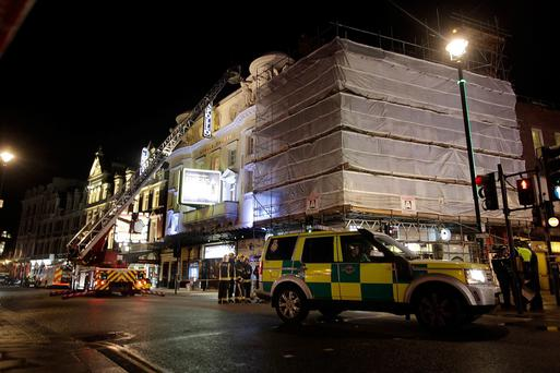 Police and fire crews in attendance on Shaftesbury Avenue outside the Apollo Theatre after the collapse of a balcony during a performance at the theatre on December 19, 2013 in London, England