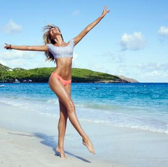 The 25-year-old showed off her killer figure as she shared some beach snaps online. (Instagram/Candice Swanepoel)