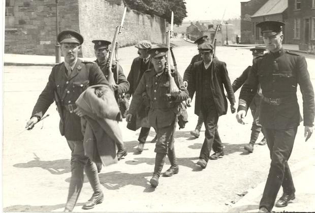 Two republican prisoners are escorted to Kilmainham Gaol in this photo from the on the Easter Rising