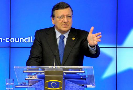 European Commission President Jose Manuel Barroso (L) during a European Union leaders summit in Brussels on Thursday