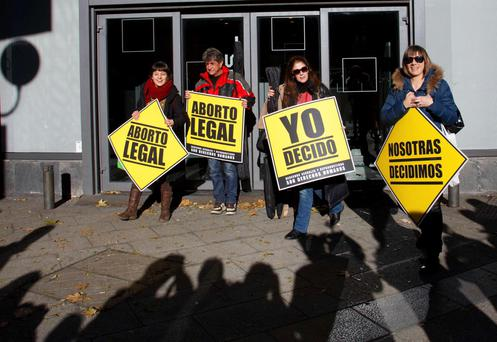 Pro-choice demonstrators hold placards in front of Spain's ruling People's Party (PP) headquarters in Madrid, yesterday