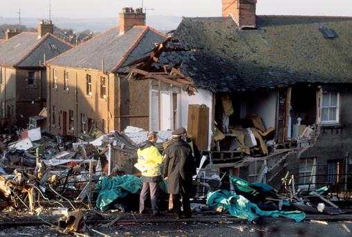File photo dated 23/12/1988 of police officers at the scene in Lockerbie, Scotland, after a Boeing 747 aeroplane, Pan Am Flight 103, crashed after a mid flight explosion on board.