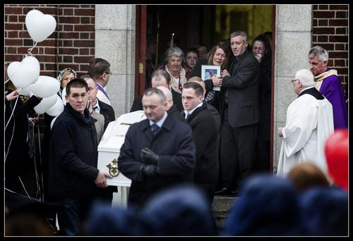 Emma Sloan's mother Caroline grieves after her funeral at the Church of our Lady of Good Counsel, Mourne Road, Crumlin. Pic: David Conaghy
