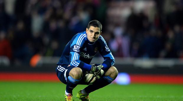 Vito Mannone of Sunderland reacts at the end of the 0-0 draw during the Barclays Premier League match between Sunderland and Norwich City at the Stadium of Light on December 21, 2013 in Sunderland, England. (Photo by Mark Runnacles/Getty Images)