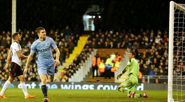 Manchester City's James Milner celebrates scoring his sides fourth goal during the Barclays Premier League match at Craven Cottage, London. PRESS ASSOCIATION Photo. Picture date: Saturday December 21, 2013. See PA story SOCCER Fulham. Photo credit should read: Stephen Pond/PA Wire. RESTRICTIONS: Editorial use only. Maximum 45 images during a match. No video emulation or promotion as 'live'. No use in games, competitions, merchandise, betting or single club/player services. No use with unofficial audio, video, data, fixtures or club/league logos.