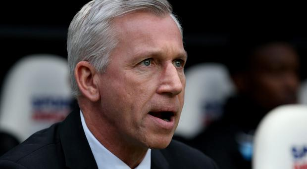 NEWCASTLE UPON TYNE, ENGLAND - DECEMBER 14: Manager of Newcastle United Alan Pardew looks on during the Barclays Premier League match between Newcastle United and Southampton at St James' Park on December 14, 2013 in Newcastle upon Tyne, England. (Photo by Jan Kruger/Getty Images)