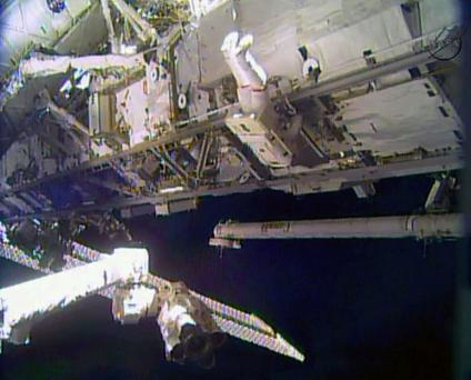 Astronaut Rick Mastracchio performs a space walk outside the International Space Station