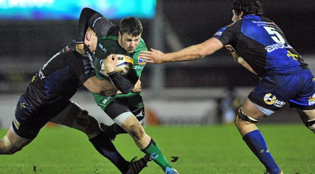 Robbie Henshaw, Connacht, is tackled by Andrew Coombs and Cory Hill, Newport Gwent Dragons