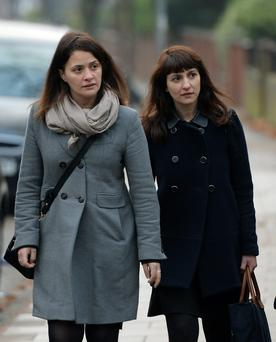 File photo dated 10/12/2013 of sisters Elisabetta (left) and Francesca Grillo. The jury in the trial of the two former personal assistants accused of defrauding Nigella Lawson and Charles Saatchi is due to continue its deliberations today. PRESS ASSOCIATION Photo. Issue date: Friday December 20, 2013. Francesca, 35, and her sister Elisabetta, 41, are alleged to have used company credit cards to spend £685,000 on items, including designer shoes and clothes, for themselves. See PA story COURTS Saatchi. Photo credit should read: Andrew Matthews/PA Wire