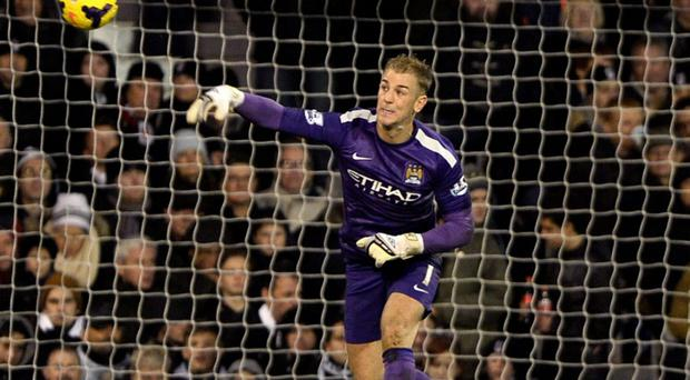 Manchester City goalkeeper Joe Hart throws the ball during their English Premier League soccer match against Fulham at Craven Cottage in London, December 21, 2013. REUTERS/Dylan Martinez (BRITAIN - Tags: SPORT SOCCER) NO USE WITH UNAUTHORIZED AUDIO, VIDEO, DATA, FIXTURE LISTS, CLUB/LEAGUE LOGOS OR