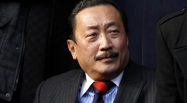 Cardiff City Chairman Vincent Tan in his seat during the Barclays Premier League match at Anfield, Liverpool. PRESS ASSOCIATION Photo. Picture date: Saturday December 21, 2013. See PA story SOCCER Liverpool. Photo credit should read: Peter Byrne/PA Wire. RESTRICTIONS: Editorial use only. Maximum 45 images during a match. No video emulation or promotion as 'live'. No use in games, competitions, merchandise, betting or single club/player services. No use with unofficial audio, video, data, fixtures or club/league logos.