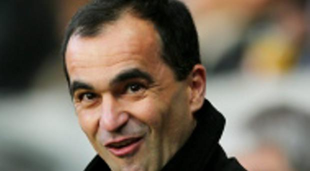 SWANSEA, WALES - DECEMBER 22: Roberto Martinez the Everton manager looks on during the Barclays Premier League match between Swansea City and Everton at the Liberty Stadium on December 22, 2013 in Swansea, Wales. (Photo by Clive Rose/Getty Images)