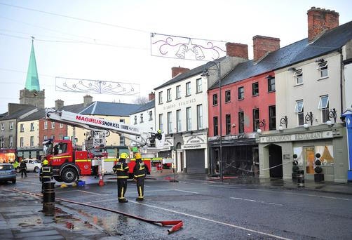 The Dundalk Cycle and Trophy Centre on Dundalk's Clambrassil St which caught fire today and is completely gutted. Picture: Ciara Wilkinson.
