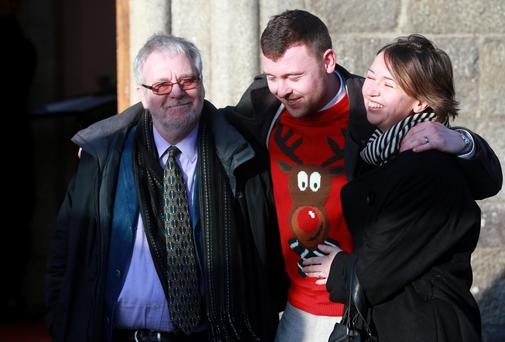 Partner Tom Curran with Marie's son Simon and daughter Corrinna at the funeral of Marie Fleming at the Church of the Holy Trinity in Castlemacadam, Avoca, Co Wicklow. Picture: Arthur Carron/Collins