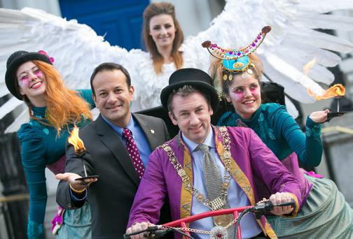 Tourism Minister Leo Varadkar and Lord Mayor of Dublin Oisín Quinn (in purple coat) with Ayesha Mailey and Janie Doherty from LUXe (in green) ; and angel Ashlene McFadden, from Fidget Feet at the launch of Dublin's New Year Festival. Picture: Naoise Culhane
