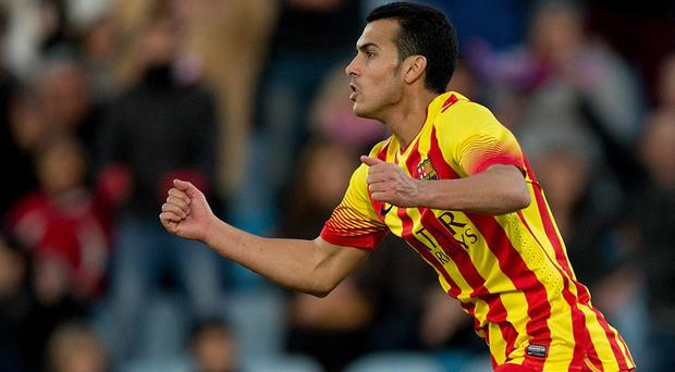 Pedro Rodriguez Ledesma of FC Barcelona celebrates scoring their third goal