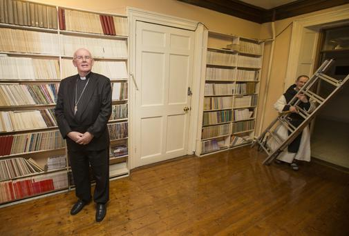 Archbishop Seán Brady with Fr Joseph in the library at Mellifont Abbey in Co Louth.