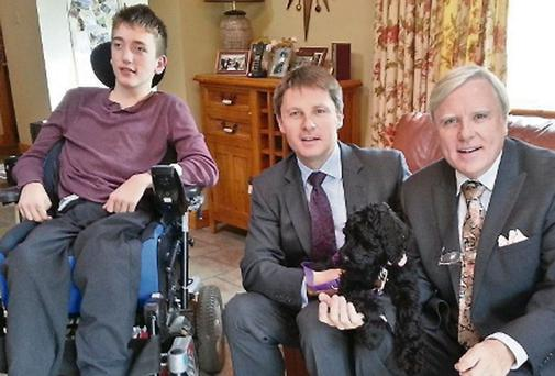 Conor Dillon (16) with TV hoteliers John and Francis Brennan after the hoteliers revamped the respite centre CASA Breakhouse in Malahide, Co Dublin, for a Christmas TV special
