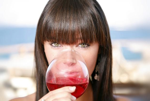 With wine being so easy to come by, a woman will have no problem reaching her maximum weekly drinking limit of 14 units in one night and it'll cost her less than €10. Pictured posed
