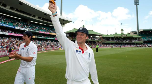 England's Graeme Swann holds the ashes urn after winning the fifth Ashes Test at the Sydney Cricket Ground, Sydney, January 2011