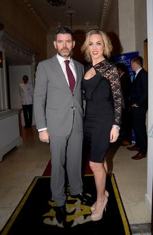 23 Dec 013; Kathryn Thomas and partner Padraig McLoughlin at the RESPECT Christmas Variety Lunch, Shelbourne Hotel, Dublin. Picture: Caroline Quinn