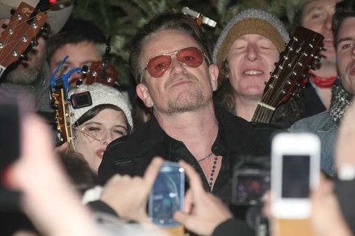 Dublin city centre - top of Grafton St - Ireland. Bono, Glen Hansard, Damien Rice, Liam O Maonlai and Mundy sang Christmas carols to raise funds for the Simon Community on Christmas Eve