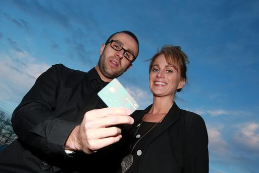 Andrew Houlihan and girlfriend Jennifer Higgins, who recently changed banks to Permanant TSB. Photo: Arthur Carron/Collins