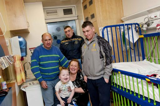 Pictured is Liam Mac An Tsaoi (centre) with his family (LtoR) Sean, Fiachna, Louise and Cormac. Photo: El Keegan