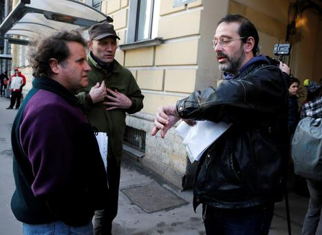 Greenpeace International activists, from left, the captain of the Greenpeace ship Arctic Sunrise Peter Willcox of the U.S., Frank Hewetson of Britain and Dima Litvinov of Sweden speak near the Federal Migration Service in St. Petersburg, Russia, Wednesday, Dec. 25, 2013.