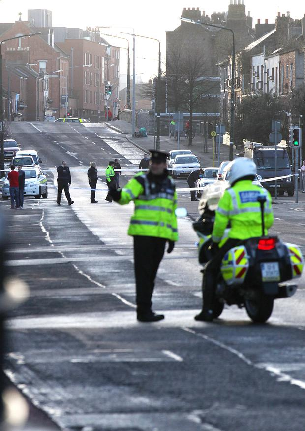 25/12/13 Garda attend the Scene of an accident between a motor bike and a car at the Ballybough Road , Dublin. Pic Stephen Collins/Collins Photos