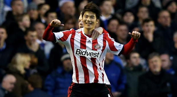 Ki Sung-Yong of Sunderland celebrates after scoring the winning goal from the penalty spot during the Barclays Premier League match between Everton and Sunderland at Goodison Park