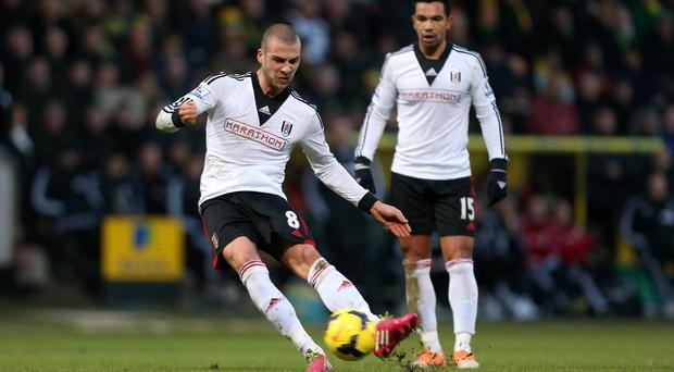 Fulham's Pajtim Kasami scores with a free kick to level the game 1-1