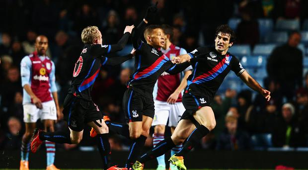 Dwight Gayle (C) of Crystal Palace celebrates with team mates after scoring the winning goal during the Barclays Premier League match between Aston Villa and Crystal Palace at Villa Park