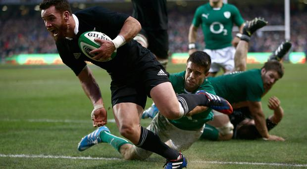 Tries and tribulations: Ryan Crotty of the All Blacks scores the match winning try against Ireland. Photo: Getty Images