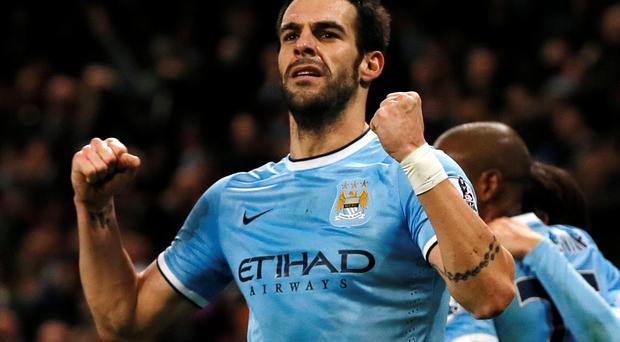 Manchester City's Alvaro Negredo celebrates after scoring a goal against Liverpool during their English Premier League soccer match at the Etihad stadium