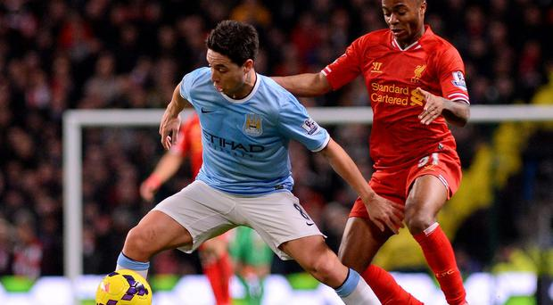 Manchester City's Samir Nasri in action with Liverpool's Raheem Sterling