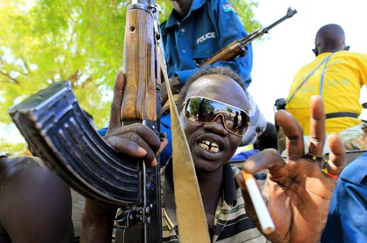 A South Sudan army soldier holds his weapon. JAMES AKENA