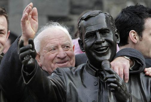 Joe Dolan's brother Paddy puts his arm around a statue unveiled in honour of the late entertainer in 2008. Photo: PA