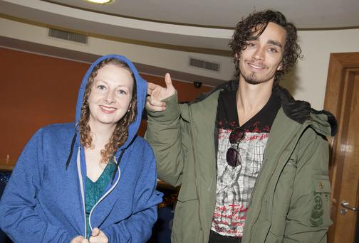 Actor Robert Sheehan presenting the infamous blue hoodie, worn by his character Darren in 'Love/Hate'to Michelle de Forge, manager of Dunamaise Arts Centre, Co Laois.