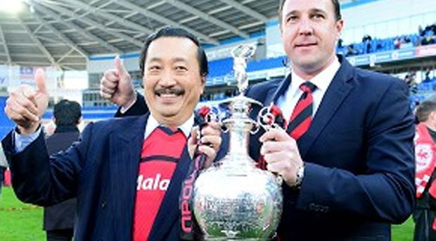Vincent Tan and Malky Mackay in happier times, when Cardiff won the Championship last season.
