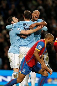 Manchester City's Edin Dzeko celebrates his goal against Crystal Palace with Alvaro Negredo (L) and Vincent Kompany (R)