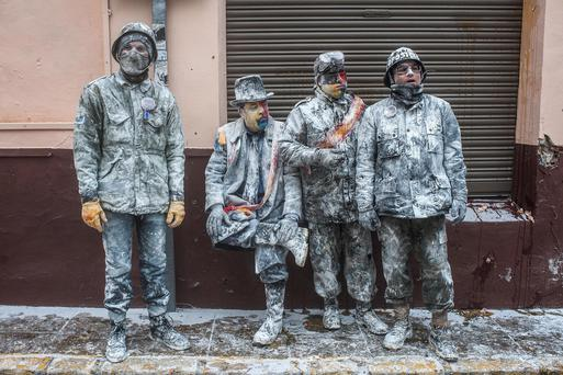 Revellers take part in the battle of 'Enfarinats', a flour fight in celebration of the Els Enfarinats festival on December 28, 2013 in Ibi, Spain