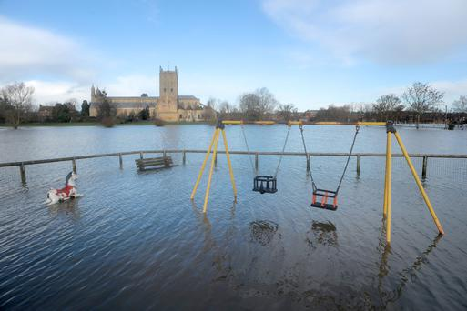Flooding outside Tewkesbury Abbey, Gloucestershire following the Christmas storms which swept Britain