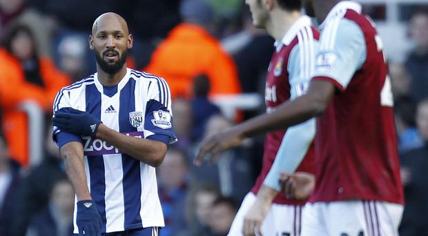 Nicolas Anelka makes the controversial 'quenelle' gesture after scoring